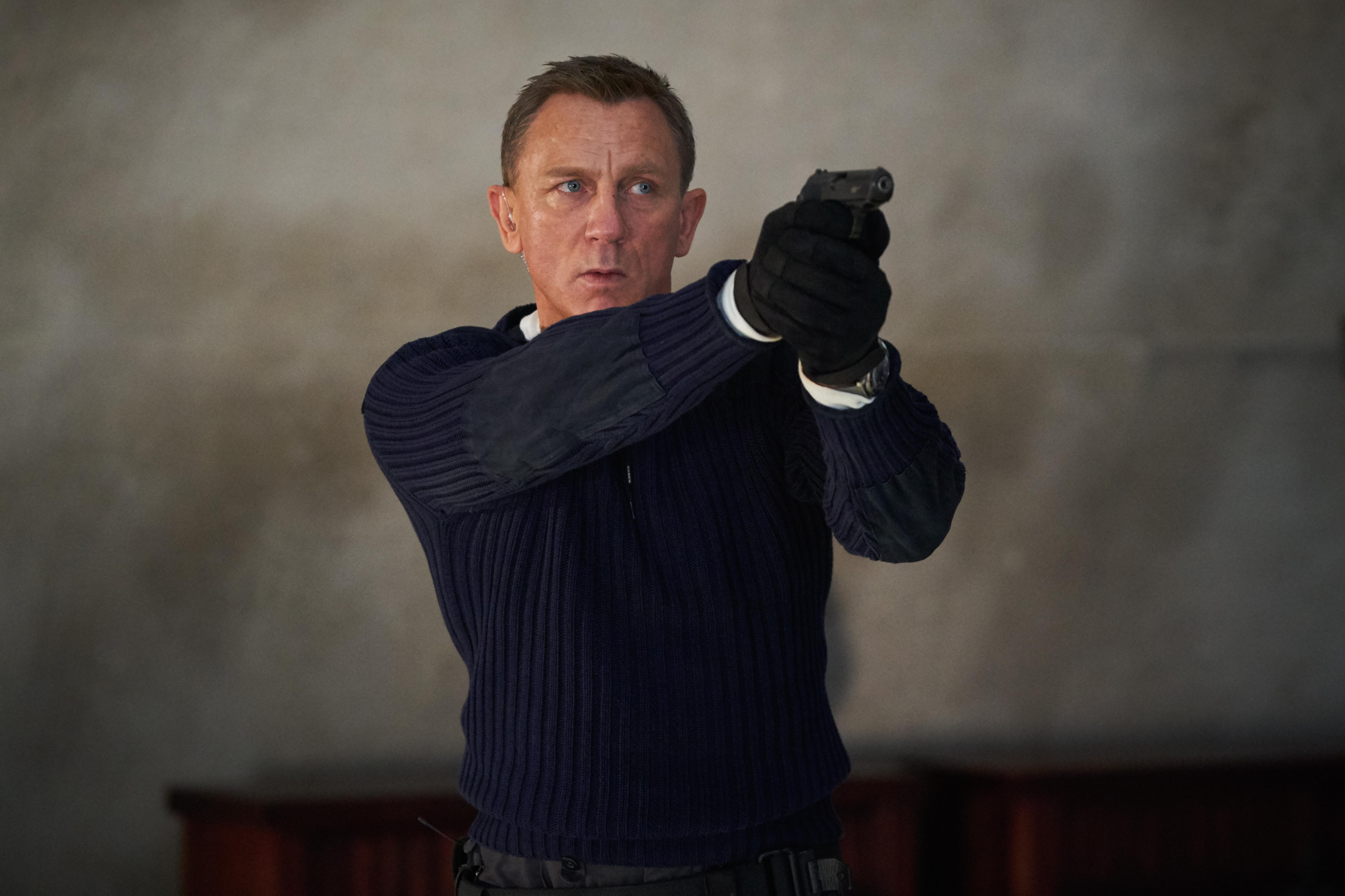 James Bond (Daniel Craig) prepares to shoot in NO TIME TO DIE. (Credit: Nicola Dove. © 2019 DANJAQ, LLC AND MGM)
