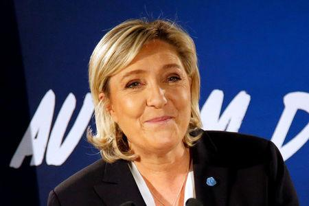 Marine Le Pen, French far-right Front National (FN) party president, member of European Parliament and candidate in the French 2017 presidential election, speaks to the media in Paris