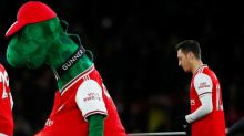 Mesut Özil offers to pay to keep man inside Gunnersaurus in Arsenal job