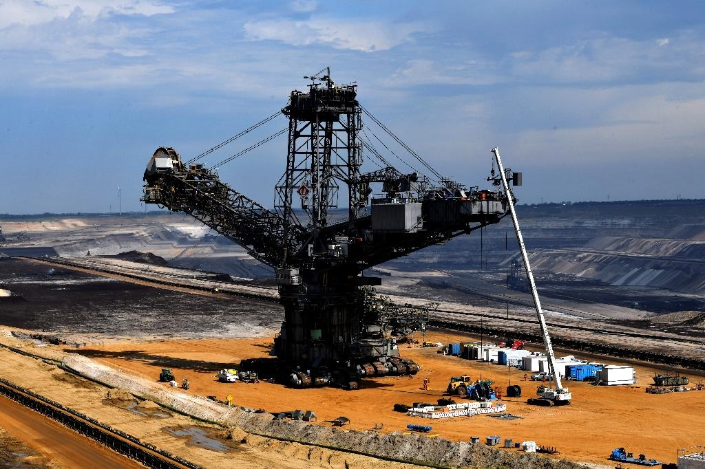 A bucket wheel excavator, used to dig brown coal, stands for repair at the Garzweiler lignite open-cast mine of German energy giant RWE, which operates three mines and power plants in the Rhineland region (AFP Photo/INA FASSBENDER)