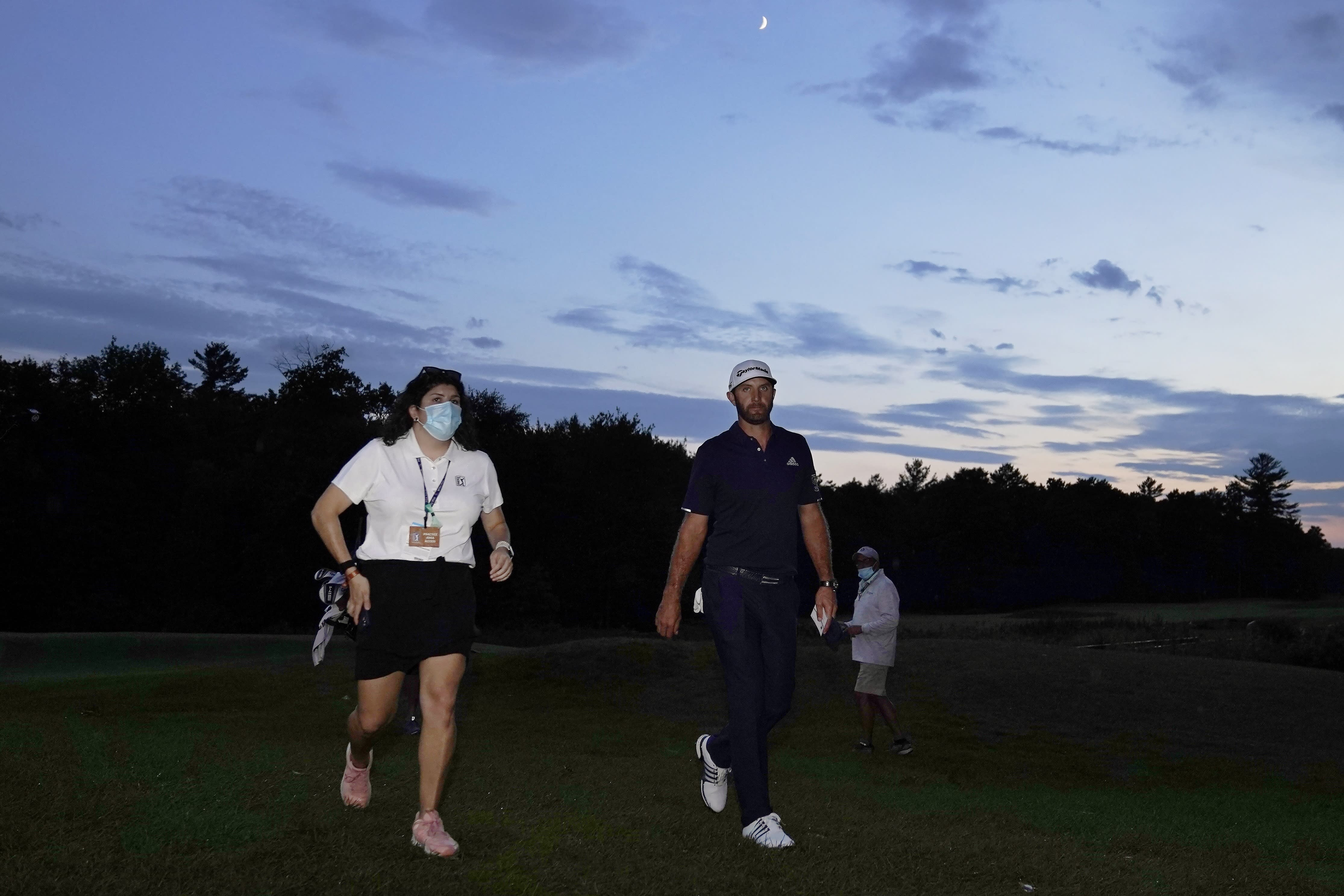 Dustin Johnson walks off the 18th green after finishing the final round of the Northern Trust golf tournament at TPC Boston, Sunday, Aug. 23, 2020, in Norton, Mass. (AP Photo/Charles Krupa)