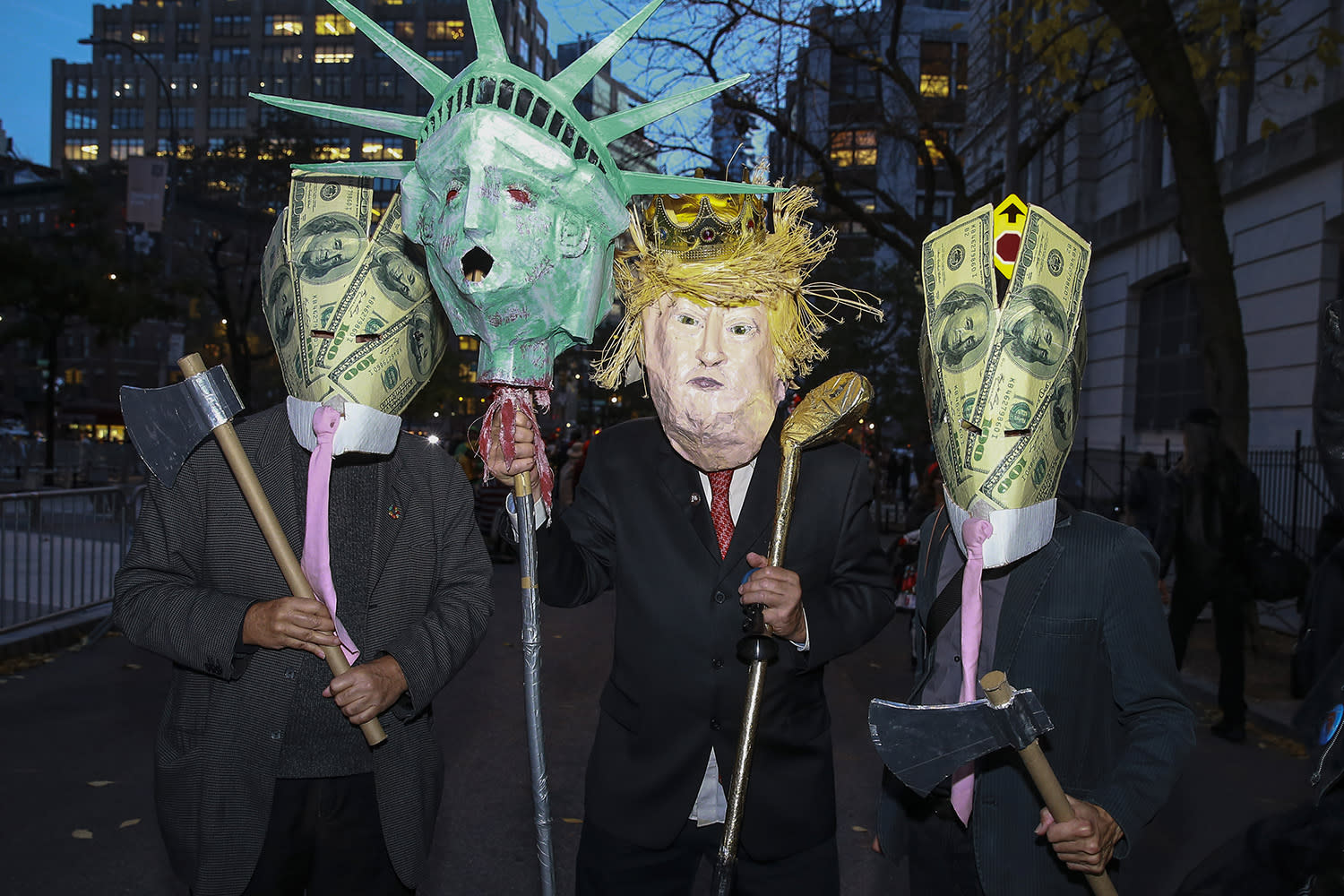 <p>People wear political costumes before the start of the 45th annual Village Halloween Parade in New York City on Oct. 31, 2018. (Gordon Donovan/Yahoo News) </p>