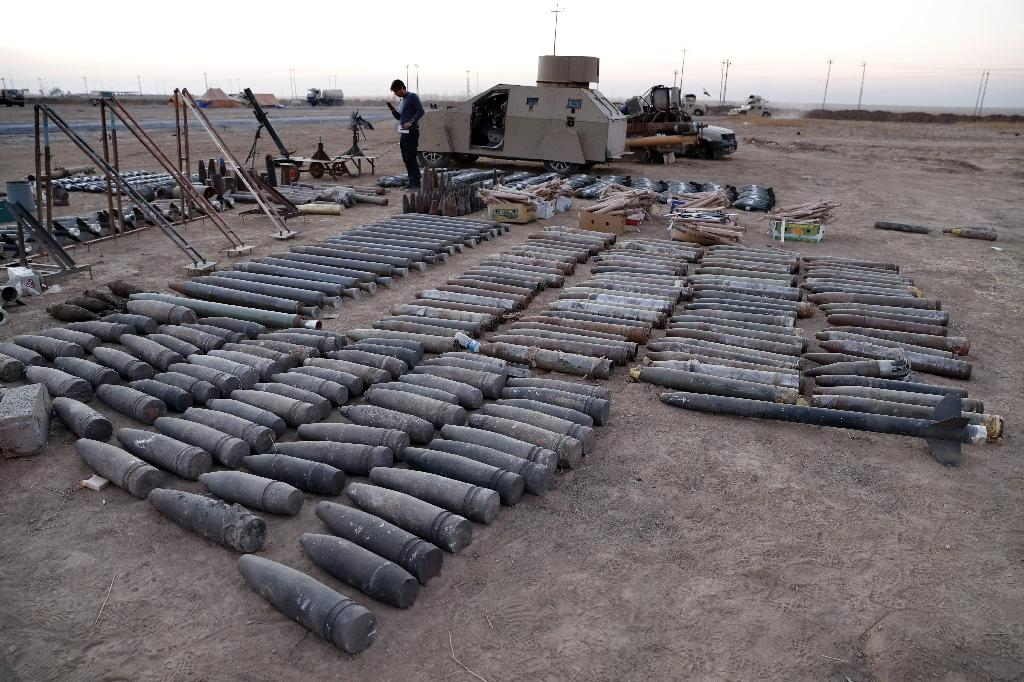 Ammunition, a homemade armoured car and mortars launchers confiscated from Islamic State group jihadists are displayed on the ground in the town of Qaraqosh, 30 kms east of Mosul, after Iraqi forces recaptured it from the group (AFP Photo/Thomas Coex)