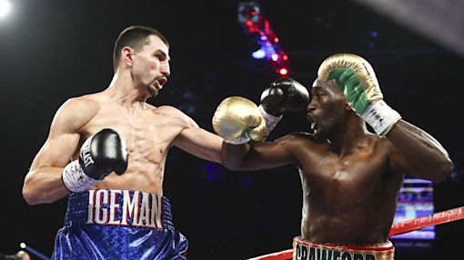 Crawford beats Postol in title unification fight