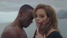 Singer receives death threats after black actor plays lover in music video