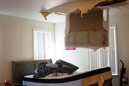 A collapsed ceiling is shown in the house of a Marine and his family whose home suffered severe damage post-Hurricane Florence at Marine Corps Base Camp Lejeune, North Carolina, U.S., September 27, 2018. REUTERS/Andrea Januta