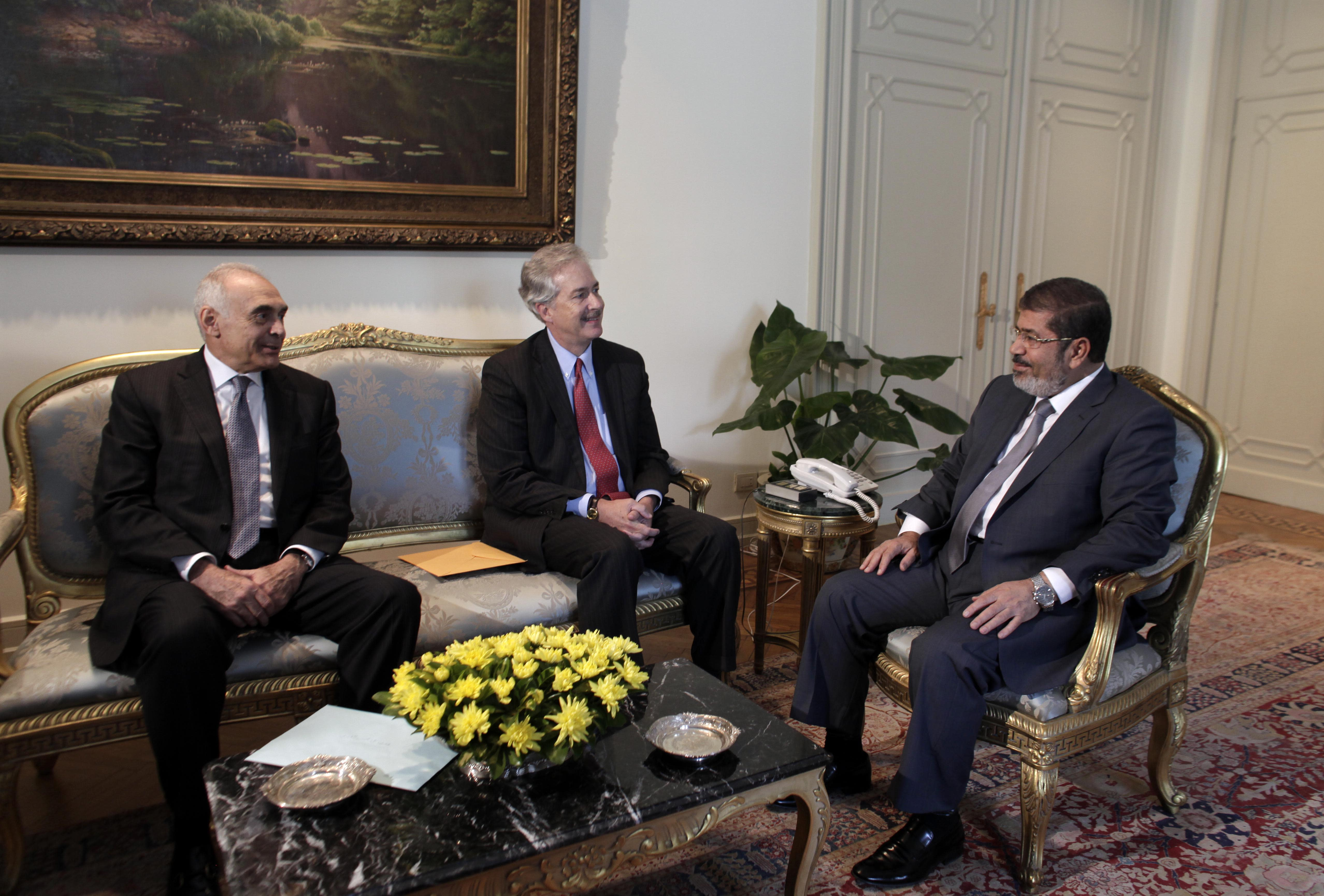 Egyptian Foreign Minister Mohammed Kamel Amr, left, meets woth U.S. Undersecretary of State William Burns, center, and President Mohammed Morsi, right, at the Presidential palace in Cairo, Egypt, Sunday, July 8, 2012. Morsi is the country's first democratically-elected president, first Islamist, and civilian to take office in Egypt. He was sworn in last week. (AP Photo/Maya Alleruzzo)