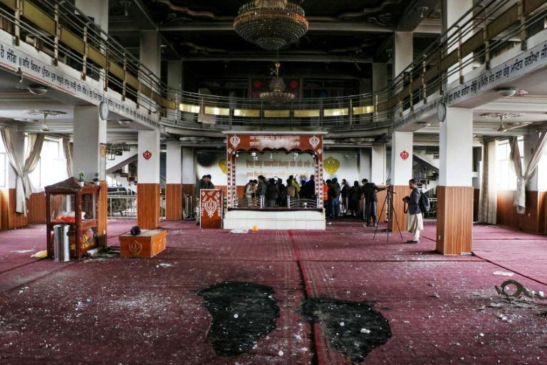 Security personnel and journalists inspect the Sikh-Hindu temple in Kabul, Afghanistan after a deadly attack highlighting the country's ongoing security crisis (AFP Photo/STR)