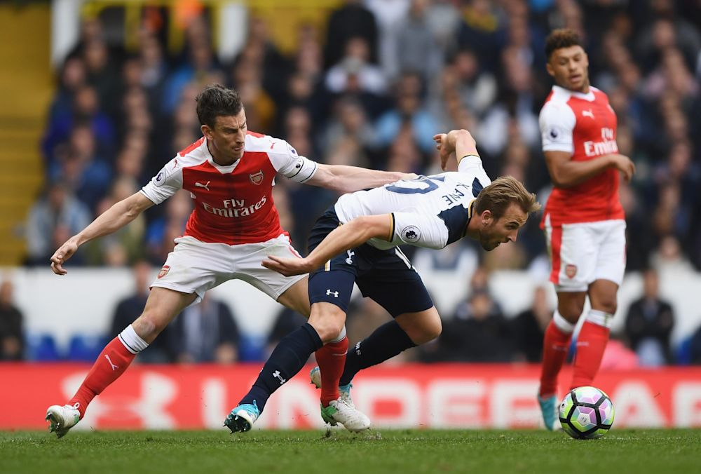 Laurent Koscielny of Arsenal puts pressure on Harry Kane of Tottenham Hotspur during the Premier League match between Tottenham Hotspur and Arsenal at White Hart Lane