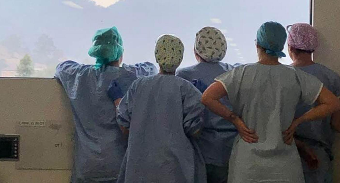 'The best medicine': Touching story behind photo of nurses staring out window