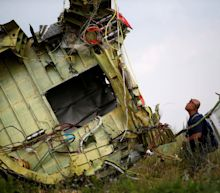 MH17: Plane shot down with Russian military missile launcher, investigators conclude