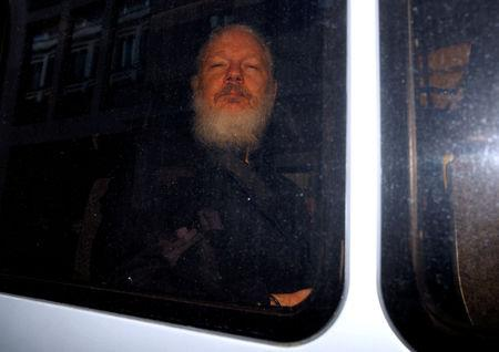WikiLeaks founder Julian Assange is seen after was arrested by British police, outside Westminster Magistrates Court in London