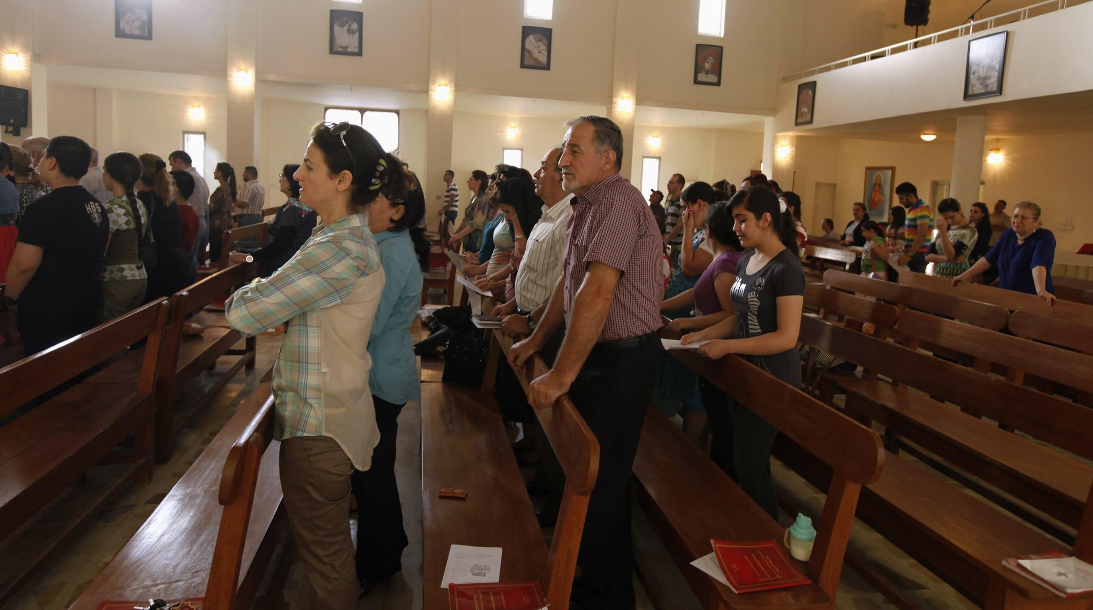 Iraqi Christians attend a mass at St. Joseph Chaldean Church in Baghdad