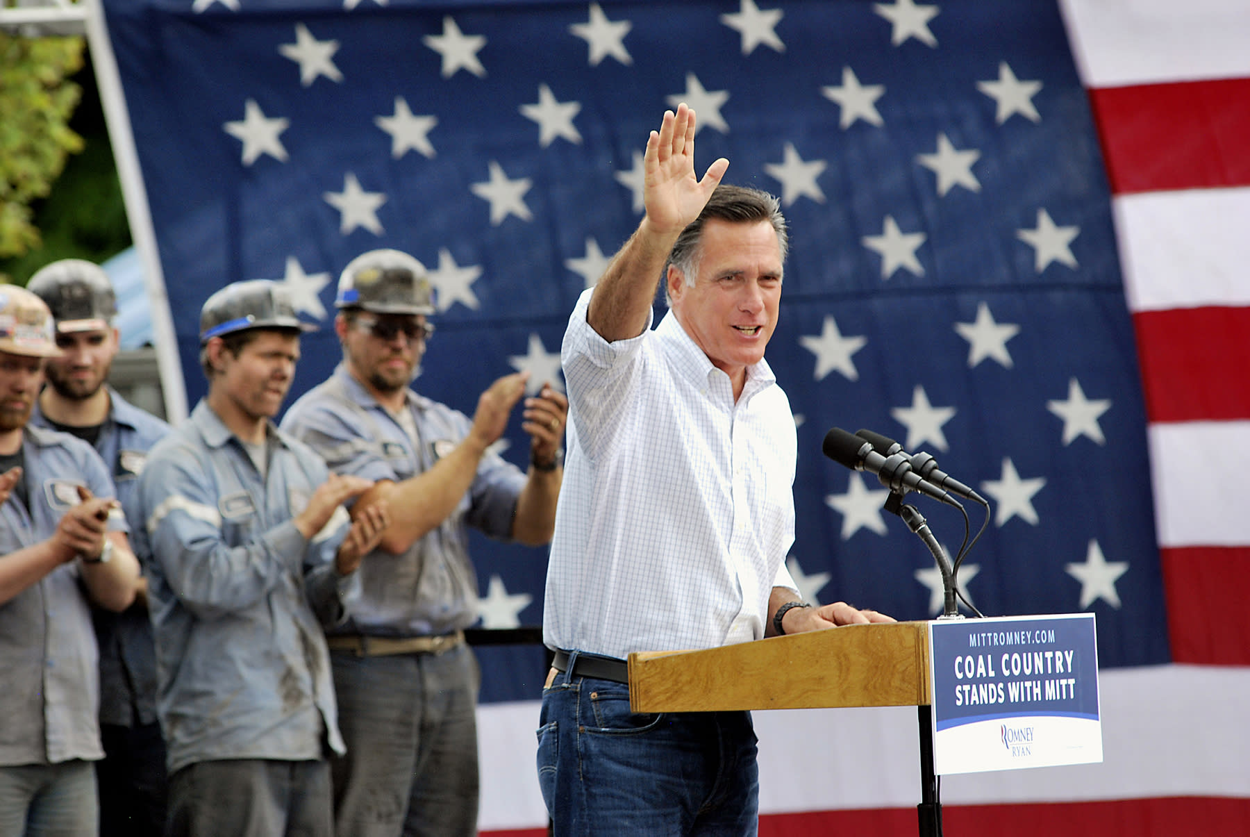 Republican presidential candidate, former Massachusetts Gov. Mitt Romney waves to the crowd during a rally Tuesday, Aug. 14, 2012, at the Century Mine Main Office Building near Beallsville, Ohio. (AP Photo/The Intelligencer, Scott Mccloskey)