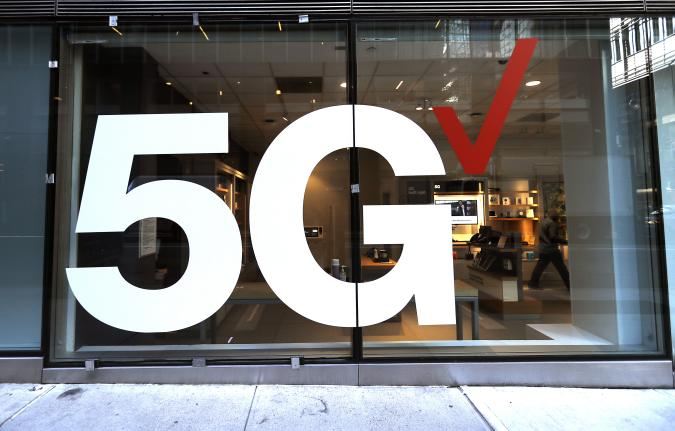 Verizon store front displays the 5G network near Grand...