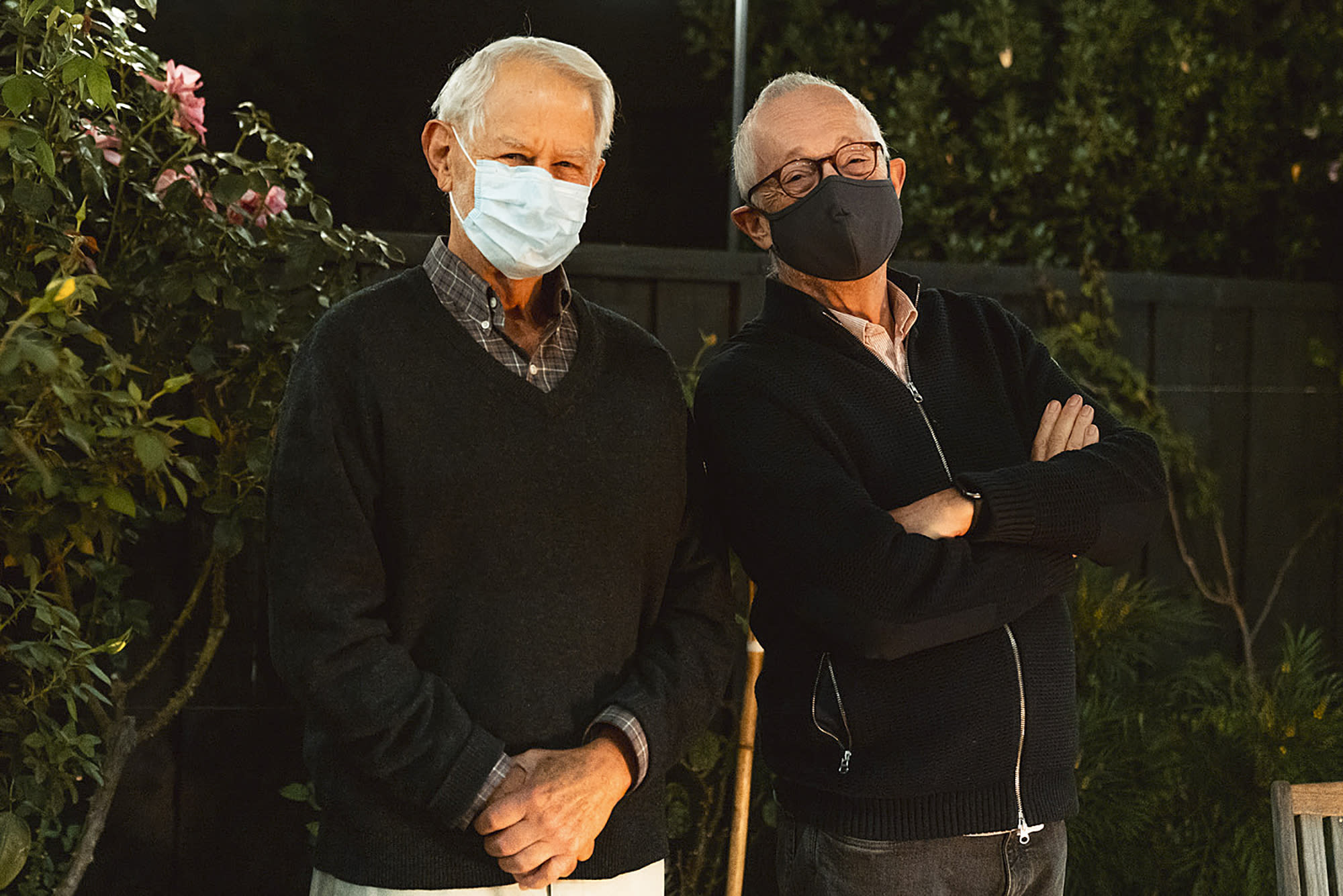 In this Monday, Oct. 12, 2020 photo provided by Stanford University, Robert Wilson, left, and Paul Milgrom wear masks as they stand for a photo in Stanford, Calif. The two American economists, both professors at Stanford, won the Nobel Prize in Economics for improving how auctions work. That research that underlies much of today's economy — from the way Google sells advertising to the way telecoms companies acquire airwaves from the government. (Andrew Brodhead/Stanford News Service via AP)