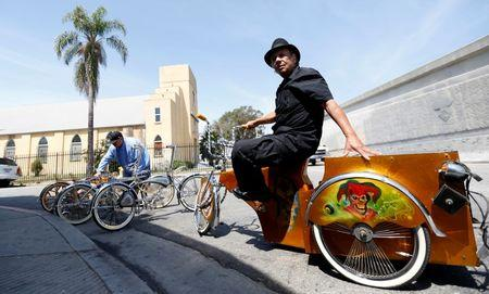 Manny Silva sits on a low rider bicycle he customized, outside his bike shop in Compton, California U.S., June 3, 2016. Picture taken June 3, 2016. REUTERS/Mario Anzuoni