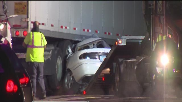 Car runs stop sign into tractor trailer, killing three