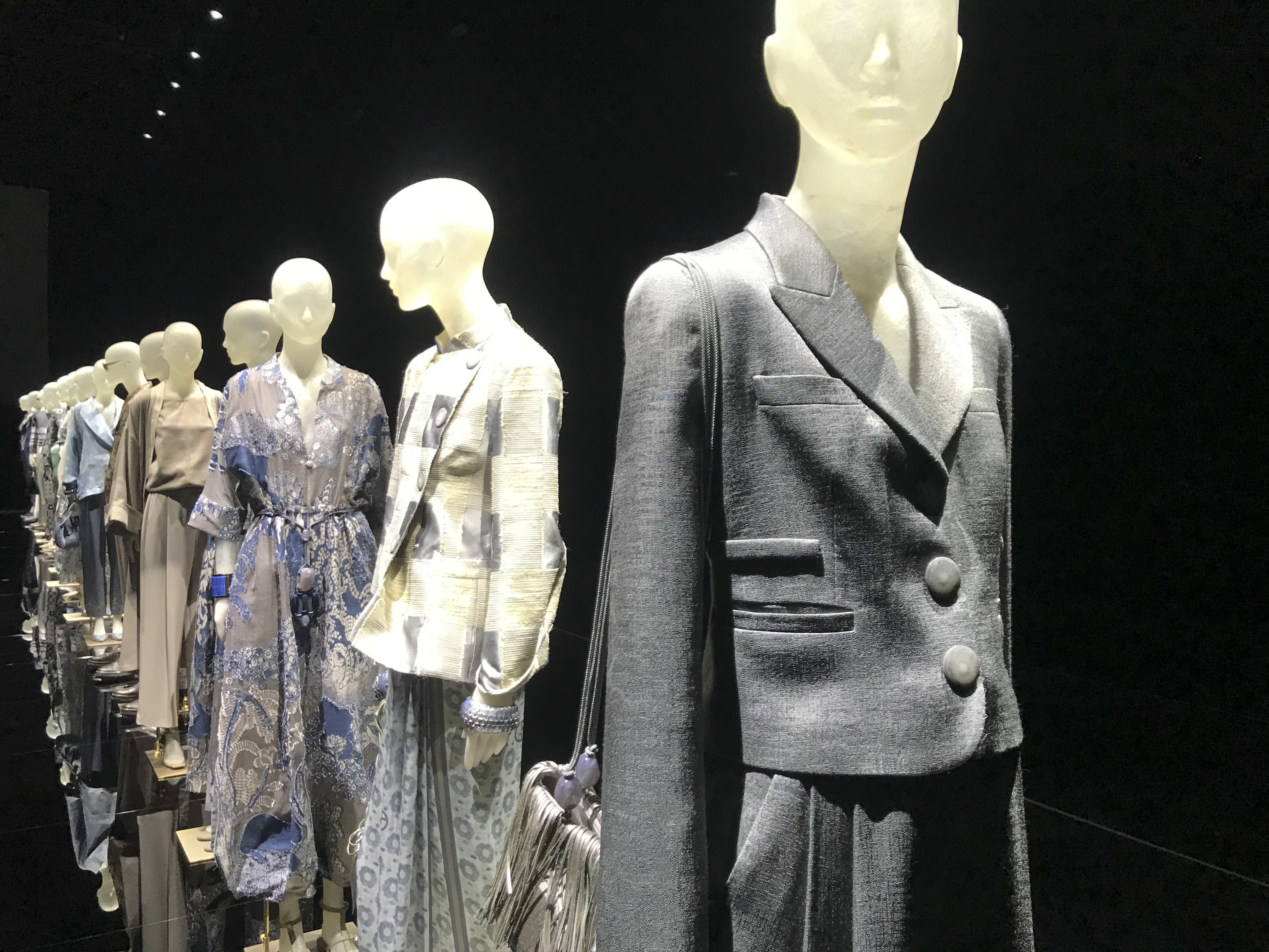 Creations displayed at a presentation as part of the Giorgio Armani 2021 women's spring-summer ready-to-wear collection during the fashion week in Milan, Italy, Saturday, Sept. 26, 2020. (AP Photo/Colleen Barry)
