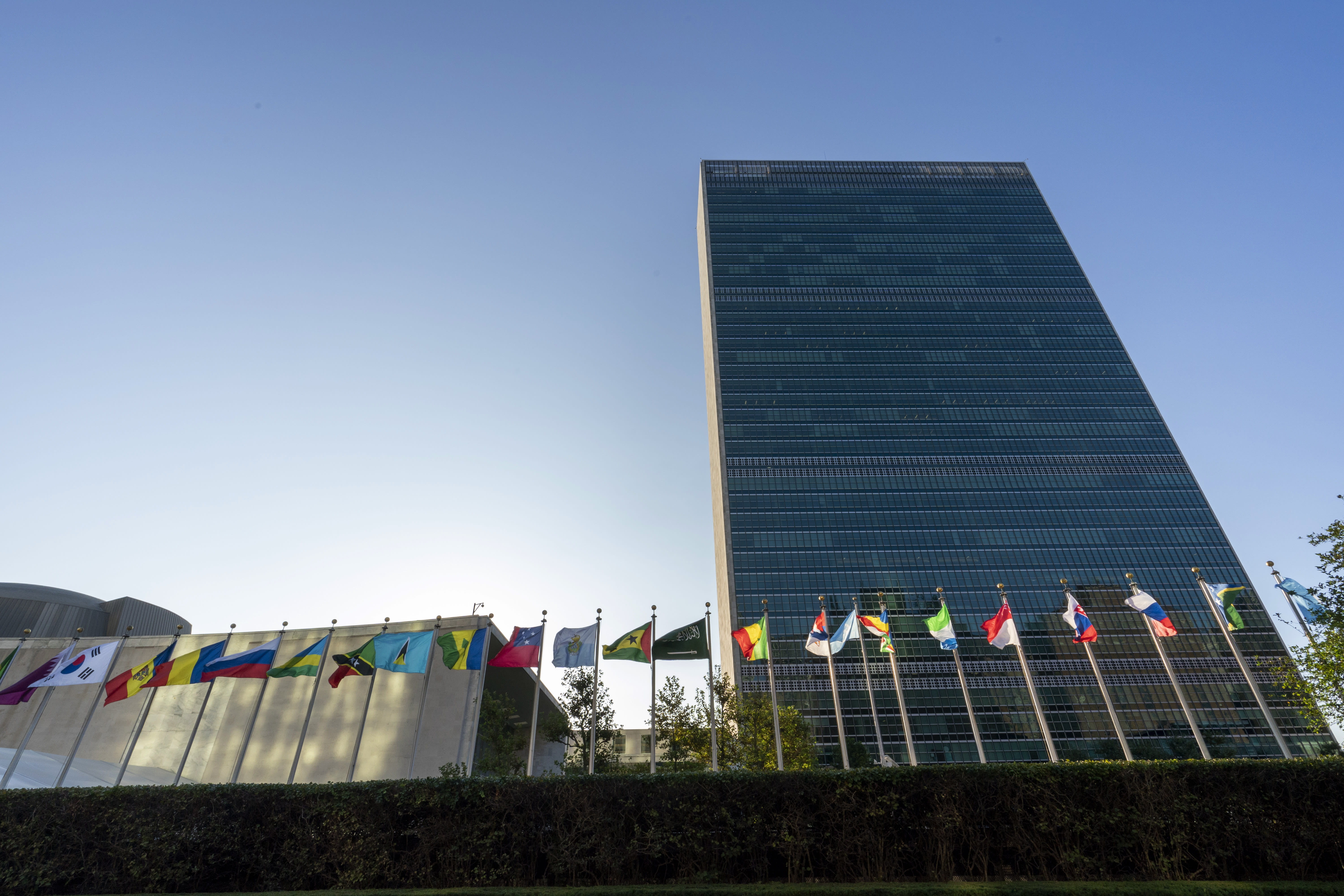 """Member state flags fly outside the United Nations headquarters during the 75th session of the United Nations General Assembly, Wednesday, Sept. 23, 2020. This year's annual gathering of world leaders at U.N. headquarters will be almost entirely """"virtual."""" Leaders have been asked to pre-record their speeches, which will be shown in the General Assembly chamber, where each of the 193 U.N. member nations are allowed to have one diplomat present. (AP Photo/Mary Altaffer)"""