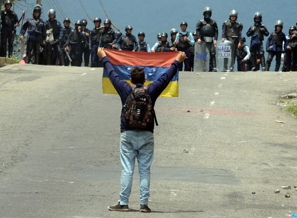 A Venezuelan protester clashes with riot police in San Cristobal, on May 11, 2016 (AFP Photo/George Castellanos)