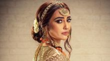 Naagin Actress Surbhi Jyoti Exudes Diva Vibes In A Heavily Embellished Peach Orange Bridal Lehenga