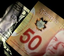 Canadian dollar rallies as records fall on Wall Street