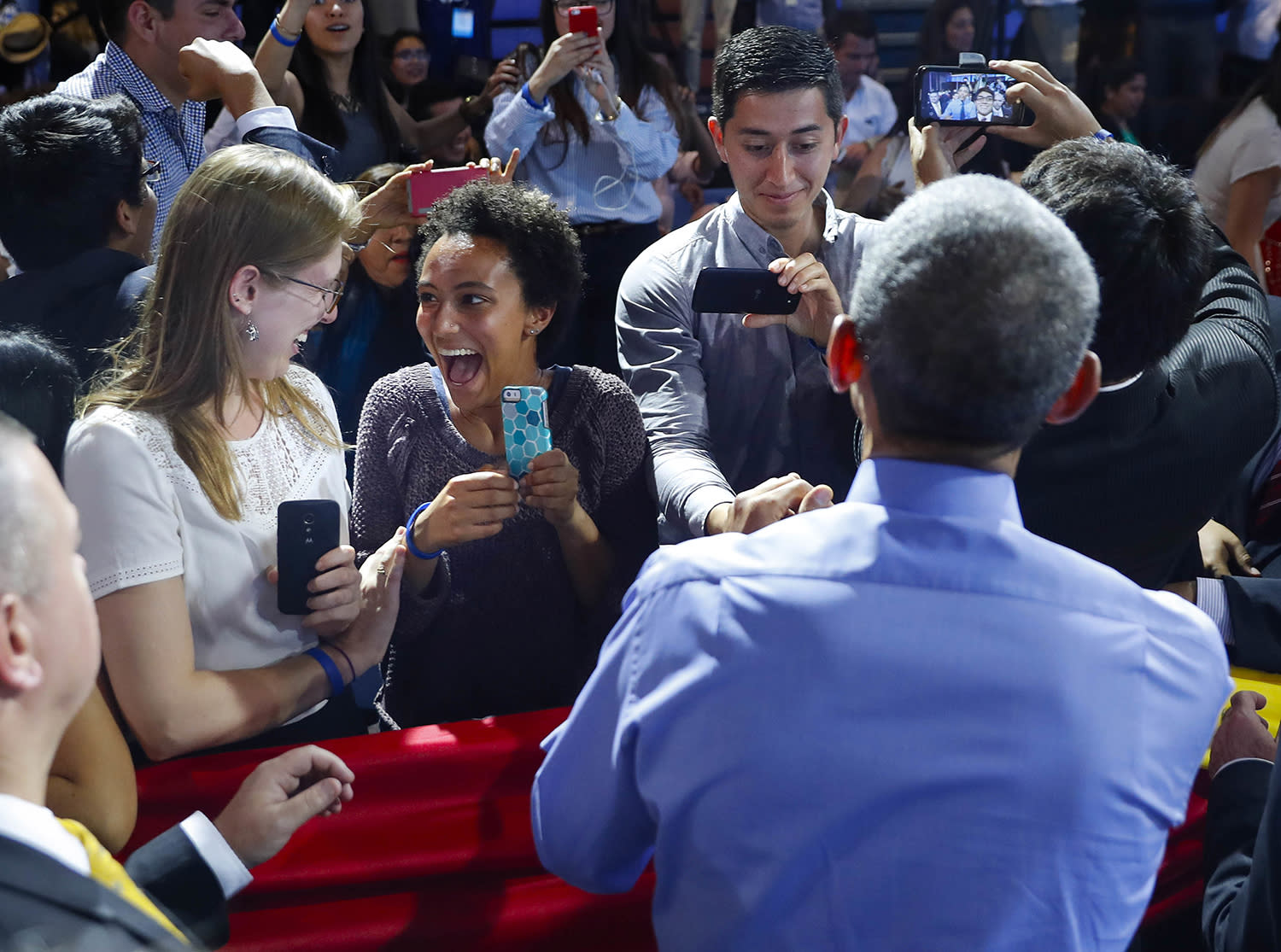<p>Two women react after greeting U.S. President Barack Obama, back to camera, who earlier spoke at a town hall with Young Leaders of the Americas Initiative (YLAI) in Lima, Peru, Nov. 19, 2016. (Photo: Pablo Martinez Monsivais/AP) </p>