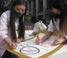 Asian American health workers fight virus and racist attacks