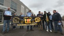General Electric workers, shareholders protest at annual meeting