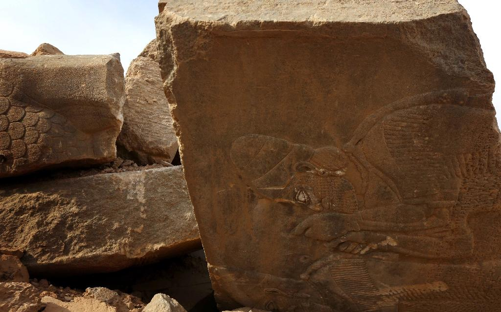 Destroyed stones at lie in the ancianet city of Nimrud, some 30 kilometres south of Mosul (AFP Photo/Safin Hamed)