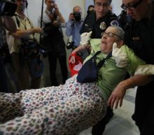 Police drag protesters away from McConnell's office in 'die-in' against Medicaid cuts