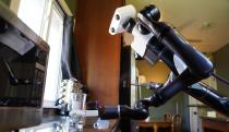 Toyota trains its robots to wipe down tables while taking selfies