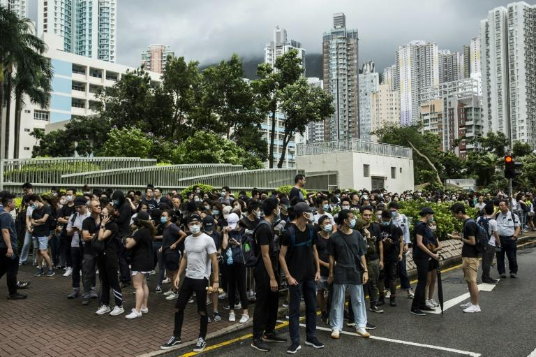 Demonstrators gathered outside the Eastern district court in Hong Kong in support of protesters who have been charged with rioting during recent clashes