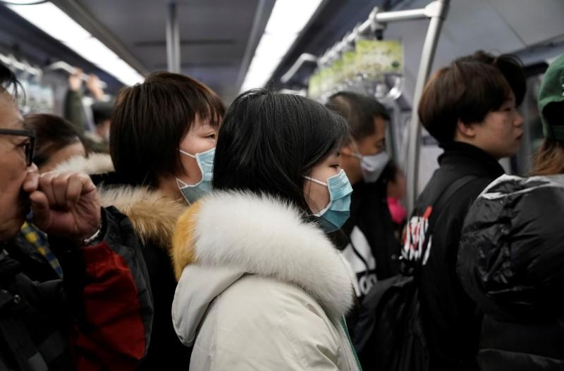China says coronavirus cases rise to 440, with nine deaths