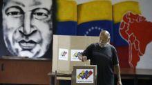 Poor Venezuelans crowd pro-Maduro stations in hope of vote 'prize'