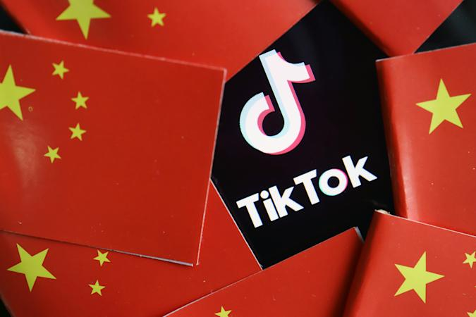 China's flags are seen near a TikTok logo in this illustration picture taken July 16, 2020. REUTERS/Florence Lo/Illustration