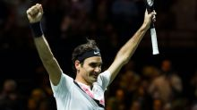 New world No.1 Federer wins Rotterdam for 97th title