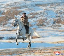 'Defiant message' as North Korea's Kim rides white horse on sacred mountain