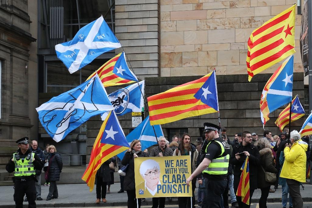 Protesters with Catalan pro-independence Estelada flags and Scottish Saltire flags have demonstrated over the case of Clara Ponsati, a former Catalan minister who is fighting an extradition request by Spain (AFP Photo/SCOTT HEPPELL)