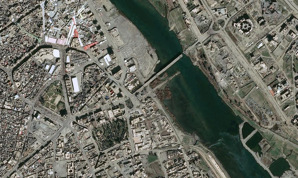 This cropped image taken on February 19, 2017 by Pleiades Satellite shows the second bridge of Mosul's five damaged or destroyed bridges across the Tigris River where battles are raging between Iraqi forces and Islamic State group fighters (AFP Photo/)