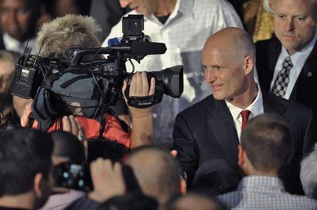 Republican Florida Governor Scott greets supporters after his re-election victory during an U.S. midterm elections night party in Bonita Springs