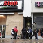 GameStop shares soar on short squeeze, then ease in wild trade session