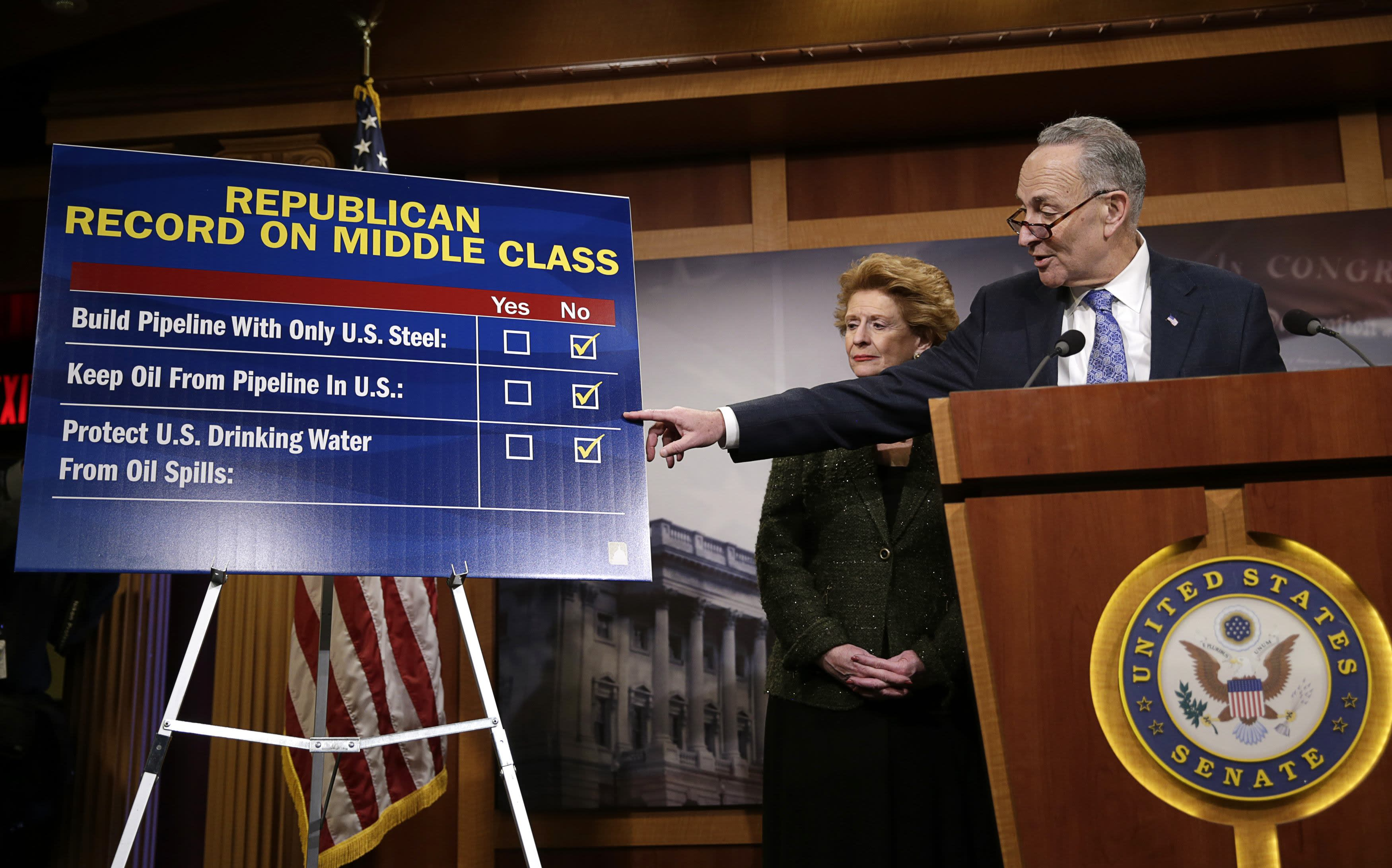 U.S. Senator Chuck Schumer (D-NY) (R) and Senator Debbie Stabenow (D-MI) (L)respond to Republicans at a Democrat response news conference after voting on amendments on the Keystone XL pipeline bill on Capitol Hill in Washington January 29, 2015. REUTERS/Gary Cameron (UNITED STATES - Tags: POLITICS ENVIRONMENT ENERGY)