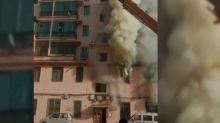 Kranführer rettet Menschen aus brennendem Haus