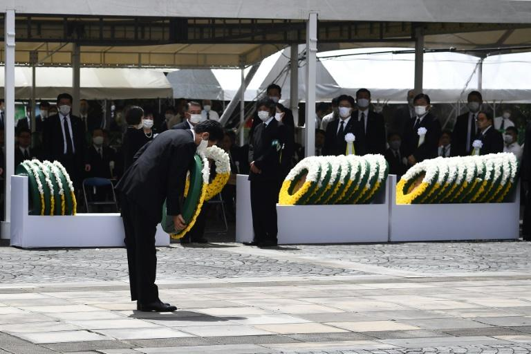 Japanese Prime Minister Shinzo Abe lays a wreath in Nagasaki on Sunday