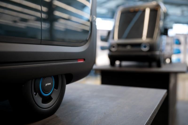 Models of the Rivian-built Amazon electric delivery vans are seen in this handout photo in Plymouth