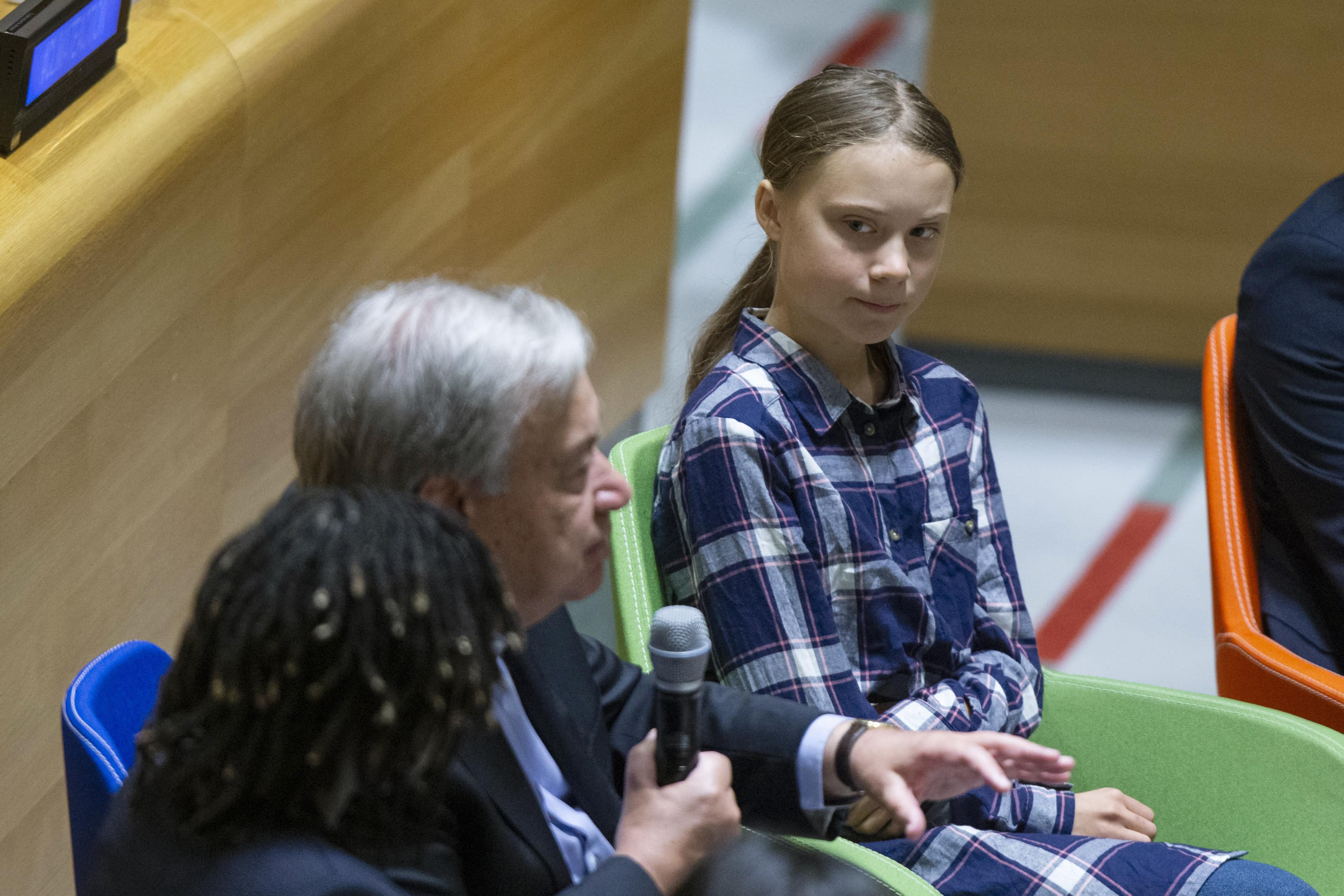 Swedish environmental activist Greta Thunberg, right, listens to U.N. Secretary-General Antonio Guterres, left, during the Youth Climate Summit at United Nations headquarters, Saturday, Sept. 21, 2019. (AP Photo/Eduardo Munoz Alvarez)