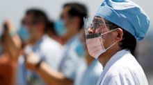 Japan health workers snub COVID-19 database as PM Suga seeks to digitize government
