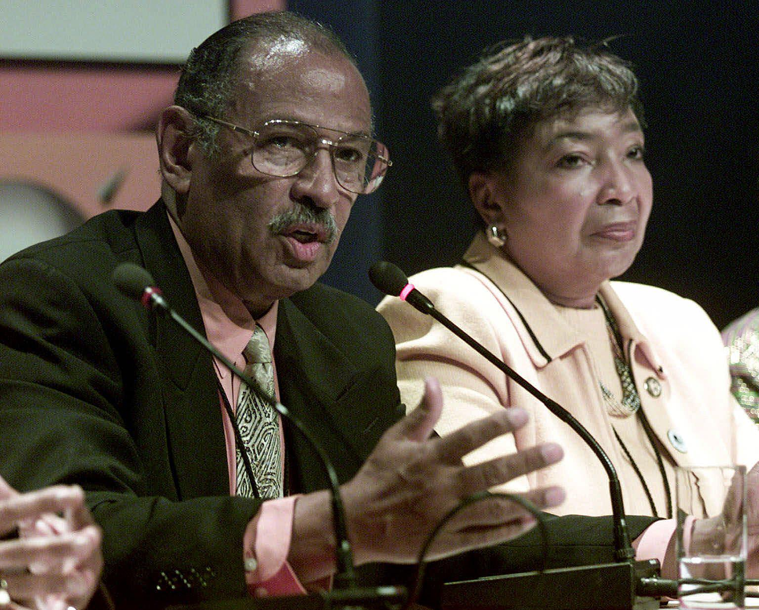 FILE - In this Sept. 2, 2001 file photo, Rep. Eddie Bernice Johnson, D-Texas, right, and Rep. John Conyers, D-Mich. are seen in Durban, South Africa. For two decades, Johnson has been an outspoken voice for Democrats in a bright blazer and multicolored scarf. But for the first time, the first black woman to represent North Texas in Congress is facing serious opposition in this month's primary. And the effort to unseat her is just one of several challenges being mounted against some of the longest-serving blacks in Congress. (AP Photo / Obed Zilwa, File)